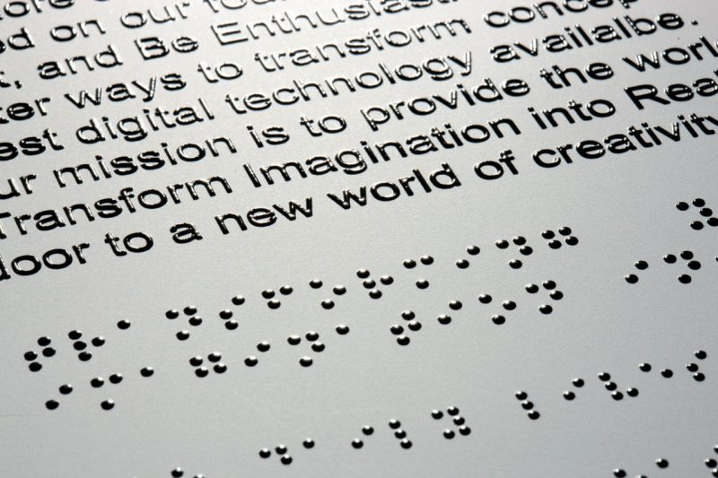 Embossed text above Braille